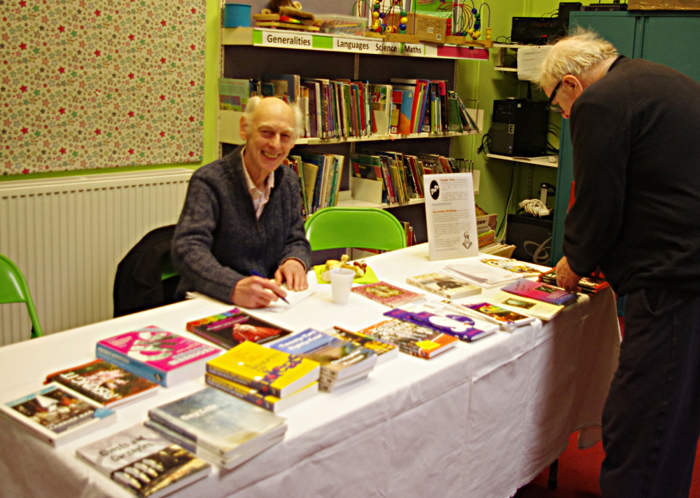 Jeffrey Doorn with a table full of books for sale
